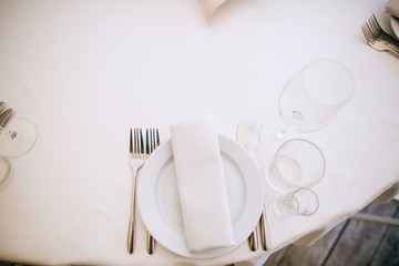 Beautiful elegant, luxury wedding reception restaurant venue with stylish white marble floor and tables