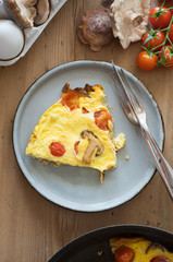 Frittata with cherry tomatoes and shiitake mushrooms
