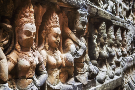 Bas relief carvings at the Leper King Terrace at Angkor, Siem Reap, Cambodia.