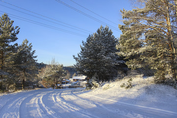 Winter landscape, Road in Russian village, Snow.