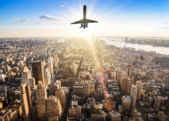 Wall Mural - airplane over the skyline of manhattan