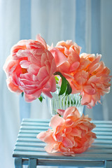 Beautiful bouquet of flowers.Close-up floral composition with a pink peonies on a blue background.