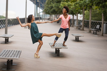 Young women dancing and balancing on one leg