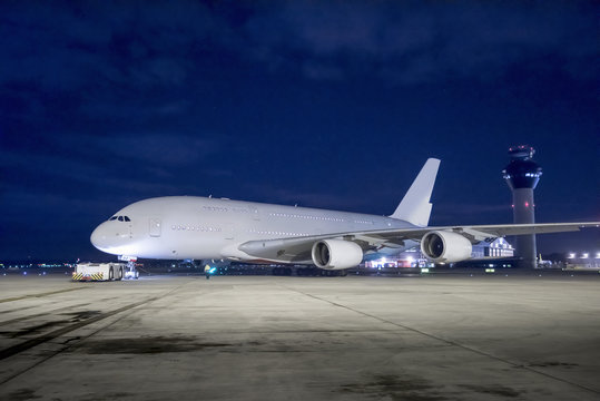 Chief engineer with A380 aircraft on runway at night