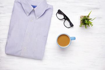 Businessman shirt on white wooden background