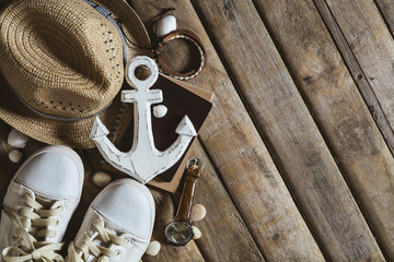 Overhead view of traveler's casual outfits, Summer background wi