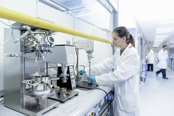 Scientist making lithium ion battery samples in battery research facility
