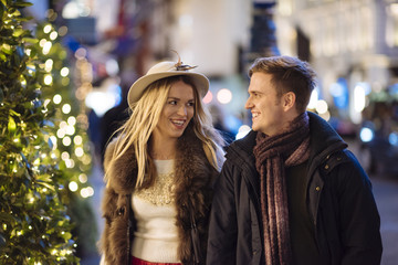 Romantic young couple strolling during Christmas
