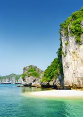 Small wild beach on tropical island in the Ha Long Bay