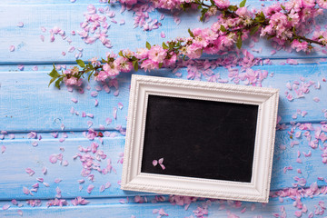 Background  with  sakura pink flowers  and empty blackboard on b
