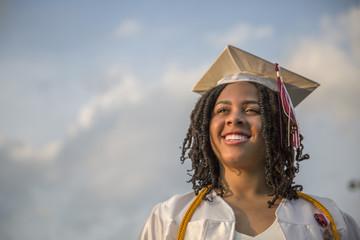 Portrait of happy teenage girl at graduation ceremony