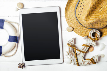 Summer vacation concept with Tablet, wood anchor, Straw hat on w