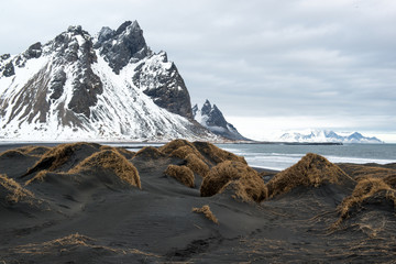 Black sand dunes and Vestrahorn mountain, ocean shore on the Stokksnes Peninsula, Iceland