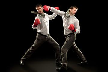 sport businessman boxing against himself