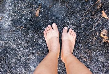 Barefoot on forest burnt cinders ground, concept world forest pr