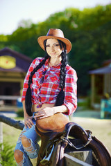 Western,cowboy,cowgirl,rodeo.Cowgirl in western style on the far