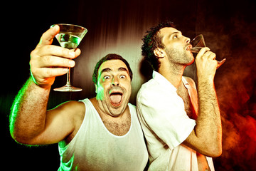 two drunk man with cocktail at club