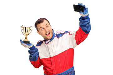 Car racing champion taking a selfie