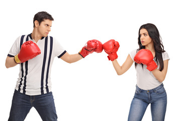 Man and woman with boxing gloves