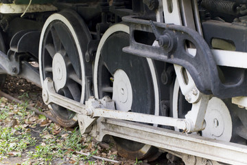 Wheel of old train in the park.