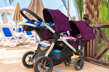 Sun holidays with twins buggie