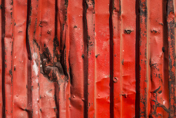 Red rusty container with blows