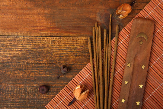 fragrant incense on a brown wooden background