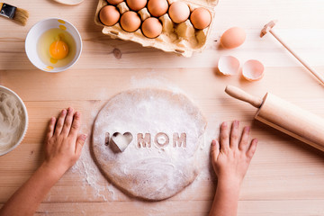 Mothers day composition. Baking cookies. Wooden background