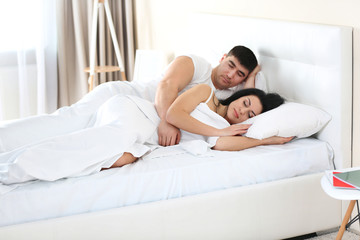 Lovely couple sleeping in white bed