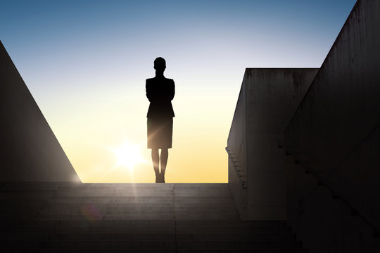 silhouette of business woman with over sun light