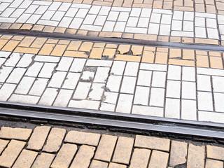 railway in a cobblestone pavement