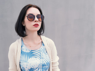 Portrait of a beautiful young woman in a sunglasses.