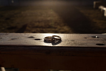 Silver wedding rings at sunset