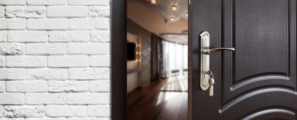 Half open door of a modern living room closeup.