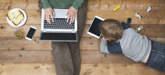 Mother and son using tablet and laptop