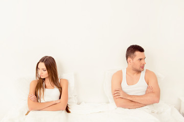 Upset young couple having marital problems or a disagreement in
