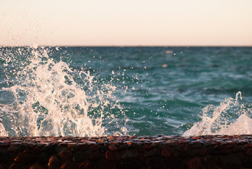 Photo closeup of beautiful clear turquoise sea ocean water surface with ripples and bright splash on seascape background, horizontal picture