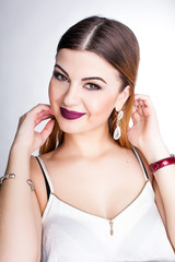 Bright positive fashion studio portrait of pretty young girl with purple lips, bright make up, sexy body, stylish trendy outfit: blue skirt, smart casual, cute emotions, color pop, white background.
