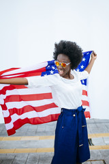 Black woman with an American flag