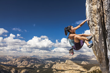 Rock climber clinging to a cliff. Wall mural