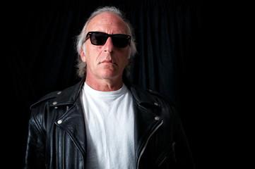 older grey haired biker