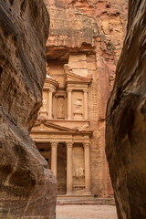 Hiking through the canyon in the ancient city of Petra (Jordan) - opening view of the famous Al-Khazneh (aka Treasury)