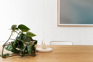Danish styled interior objects with artwork on white brick wall