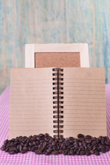 coffee beans with note book