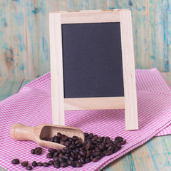 coffee beans and menu board on the wooden table