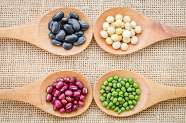 Mix from different beans on sack background.
