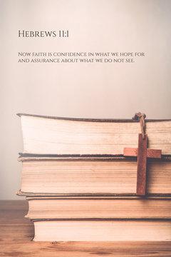 Hebrews 11:1 Vintage tone of wooden cross on book background