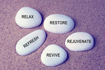 Photo sur cadre textile Zen pierres a sable Wellness, spa and beauty concept - Relax, restore, refresh, rejuvenate and revive text on zen stones retro style background