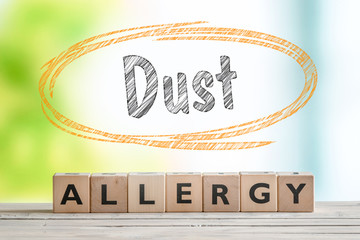 Dust allergy headline on a wooden table