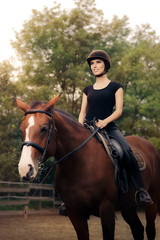 Happy Horsewoman Ridding  in a Manege
